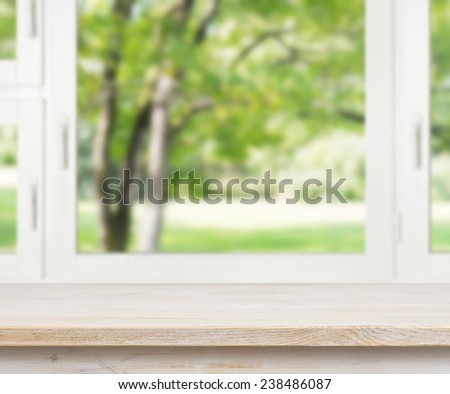 Wooden table over summer window background - stock photo