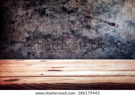 wooden table over wall grunge background with space for text or photo, Black and white - stock photo
