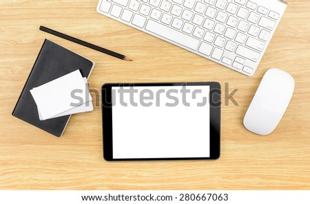 Wooden table top with tablet,black notebook,pencil,keyboard and mouse,Template mock up for business, Clipping path on tablet screen and business card - stock photo