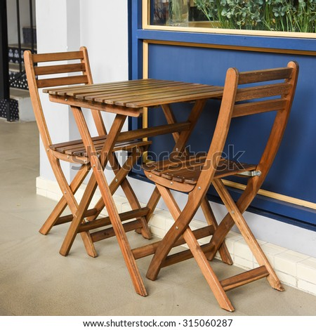 Wooden table with chairs - stock photo