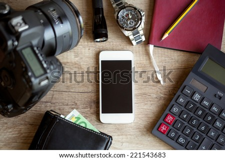 wooden table with travel and photography items - stock photo