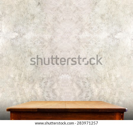 wooden tabletop at concrete wall,Template mock up for display of product,Business presentation. - stock photo