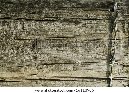 Wooden texture with barbed wire - stock photo