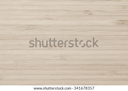 Wooden textured grainy detail backdrop in natural light sepia cream brown color tone: Bamboo wood laminated board detailed texture pattern background in tan creme beige toned colour  - stock photo