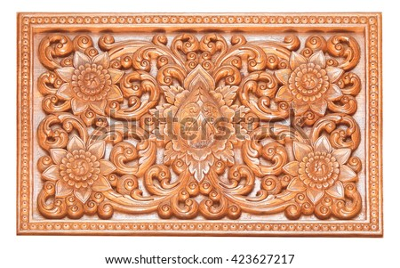 Wooden thai style craving on wall or roof in temple of northern Thailand. - stock photo