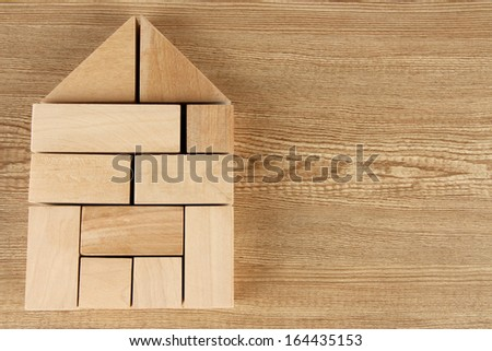 Wooden toy blocks on wooden background - stock photo