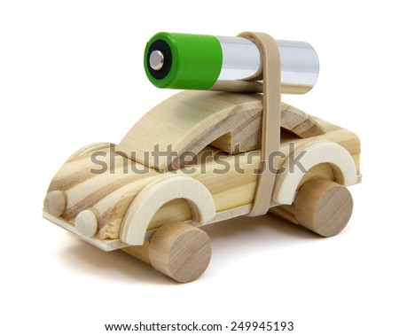 Wooden toy car with a double A battery strapped to the top. - stock photo