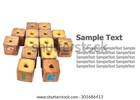 wooden toy cubes with letters. Wooden alphabet blocks isolated on white background  - stock photo