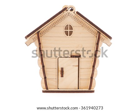 Wooden toy house on a white background - stock photo