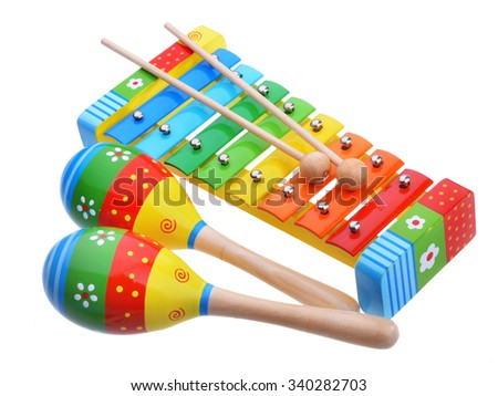 Wooden toy music instruments isolated on white background - stock photo