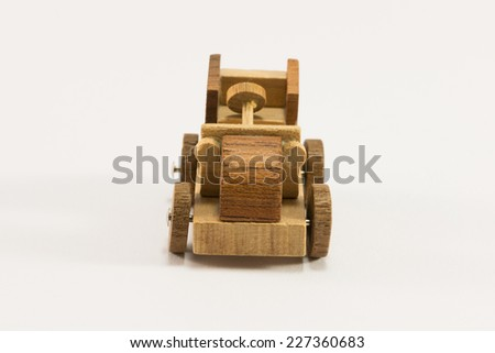 Wooden toy old car miniature - stock photo