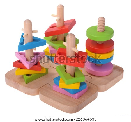 Wooden toy puzzle colorful blocks isolated over white - stock photo