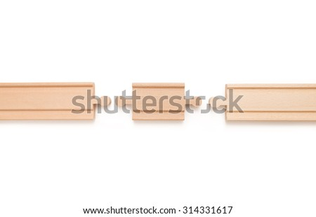 Wooden toy railroad track. Conceptual image of connection, pieces and travel - stock photo