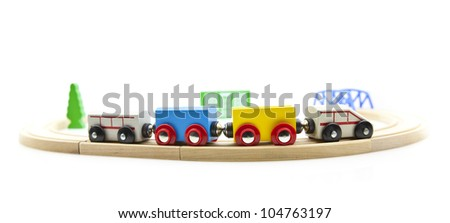 Wooden toy train isolated on a white background - stock photo