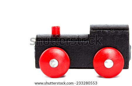 Wooden toy train on white background - stock photo