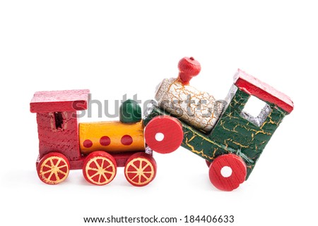 Wooden toy trains isolated on white background - stock photo