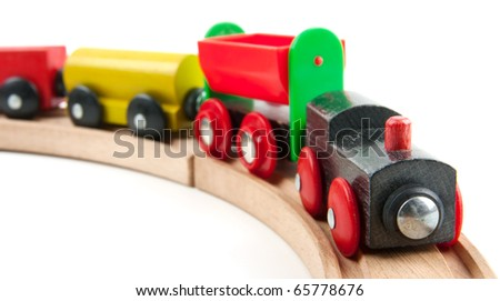 Wooden train toy isolated on white - stock photo