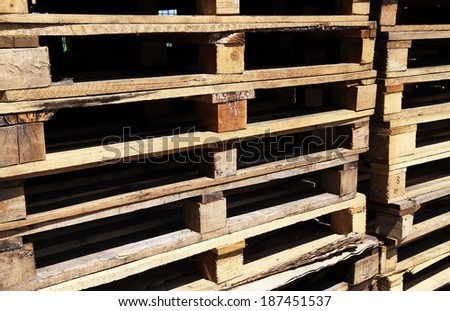 Wooden transport pallets in stacks - stock photo