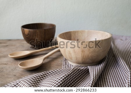 Wooden utensils on wood table - stock photo