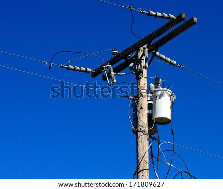 Wooden Utilities Pole With Transformers, Conductors And Wires - stock photo