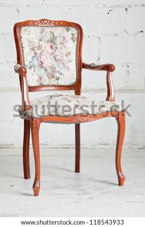 wooden vintage armchair sofa in vintage room - stock photo
