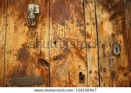 Wooden vintage background.Close up on old door. - stock photo