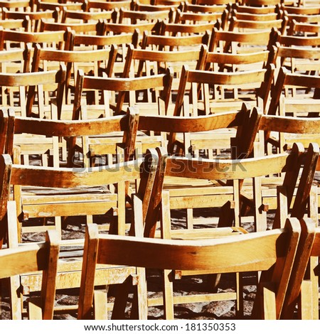 Wooden vintage empty chairs in sunlight - stock photo