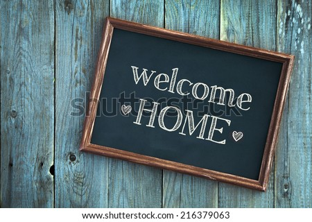 wooden vintage frame WELCOME HOME over old blue wooden background  - stock photo