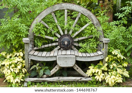 Wooden wagon wheel chair. - stock photo
