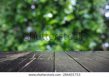 Wooden walkway and bokeh background - stock photo