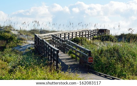Wooden walkway to the beach at St. Augustine, Florida. - stock photo