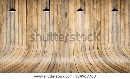 Wooden wall and floor with shining lamp on top. Background texture - stock photo
