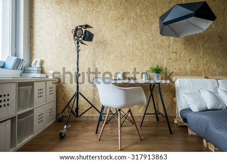 Wooden wall and simple furniture in contemporary bedroom - stock photo