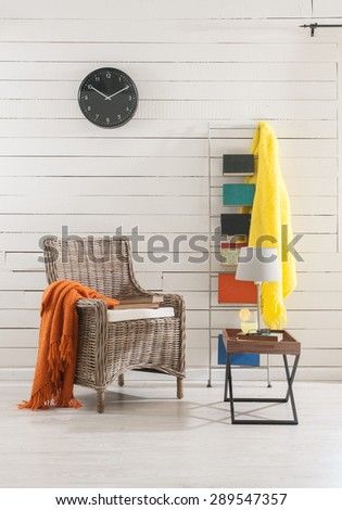 wooden wall clock on the office environment and the wicker chair   - stock photo