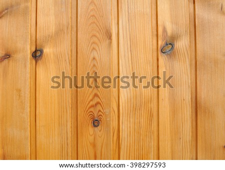 Wooden Wall of Planed Pine Boards with Knots - stock photo