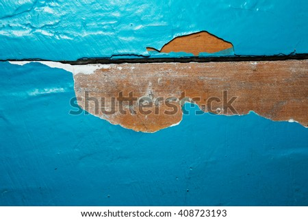 Wooden wall with peeling paint. Paint peeling plaster walls. Old wooden painted blue rustic background, paint peeling - stock photo
