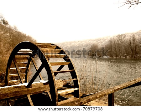 Wooden wheel of an old watermill on the river Mreznica in Croatia. - stock photo