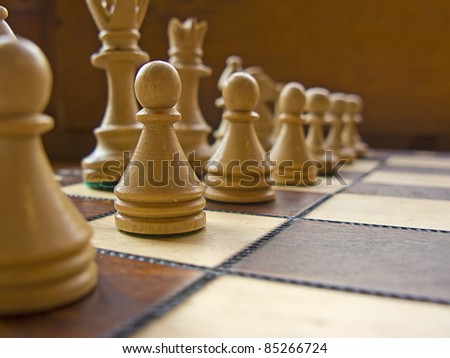 Wooden white and brown chessboard close-up - stock photo