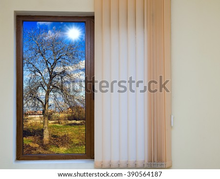wooden window blinds in a house with a beautiful landscape - stock photo