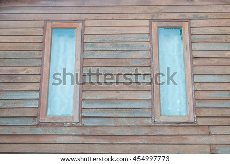 wooden window in old wood wall - stock photo