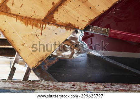 wooden yacht in small shipyard for repair and restoration its hull - stock photo