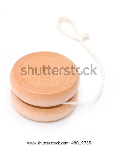 Wooden yo-yo toy isolated on white - stock photo