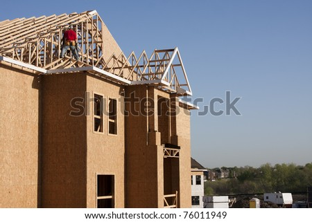 woodframe of new building construction - stock photo