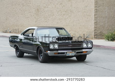 Woodland Hills, CA, USA - July 5, 2015: Plymouth GTX car on display at the Supercar Sunday car event. - stock photo