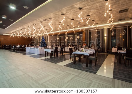 Woodland hotel - Dining room in new luxurious hotel - stock photo