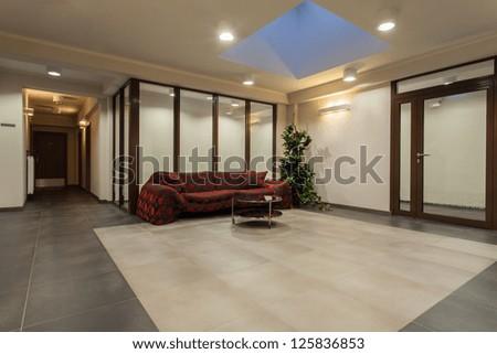 Woodland hotel - Elegant hotel interior, hall with sofa - stock photo