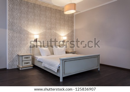Woodland hotel - Interior of a bright bedroom in a hotel - stock photo