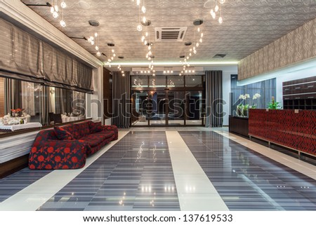 Woodland hotel - main entrance, luxurious hall and couch - stock photo