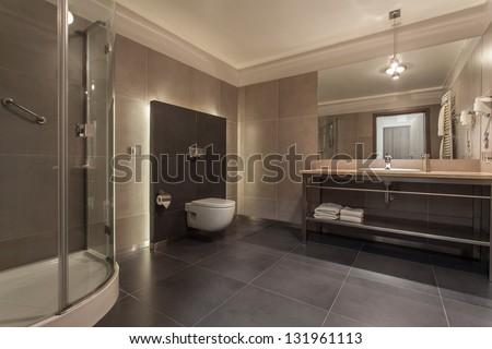 Woodland hotel - modern bathroom with a shower - stock photo