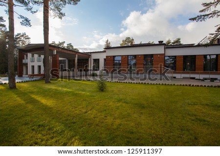 Woodland hotel - Outdoors view of a modern hotel - stock photo